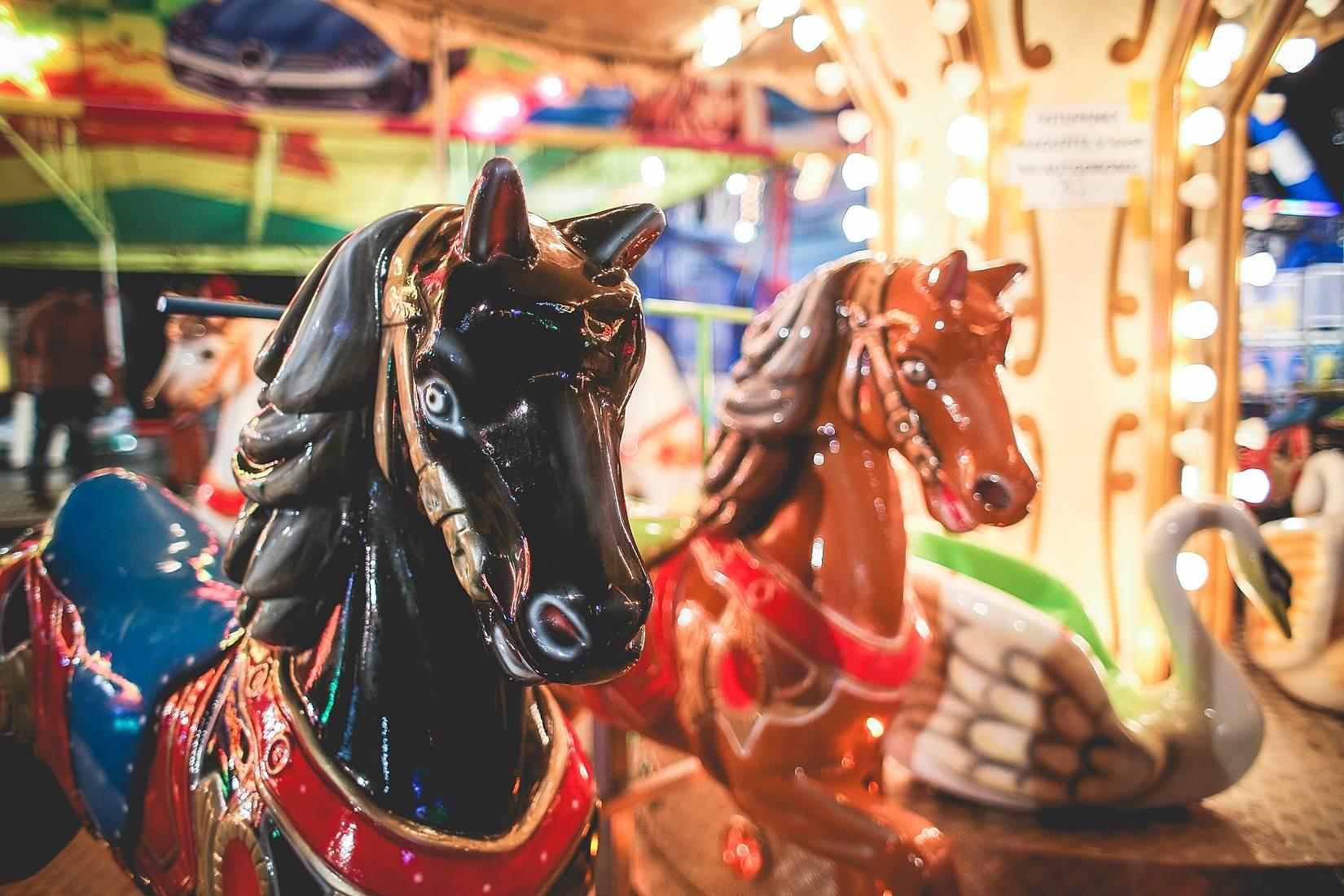 Traditional Carousel Horses on a Fun Fair Ride